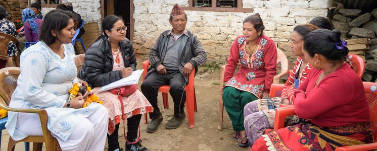 "An evaluation team talks to people in Lakuridanda / Nepal about the results of a project of the partner organisation ""Rural Reconstruction Nepal"". After an earthquake, they received help to maintain their livelihood. (Photo: Thomas Lohnes)"